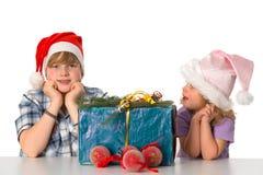 Boy and girl with christmas present Royalty Free Stock Image