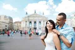 Boy and girl in the city on the square, spinning in the dance, cheerful lovers dreaming, walk the city, set royalty free stock photo