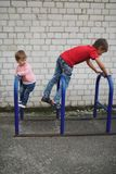 Boy and girl climb on bike parking. Little boy and girl climb on bike parking royalty free stock photos