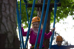 Boy and girl  climbing in adventure park Royalty Free Stock Photography