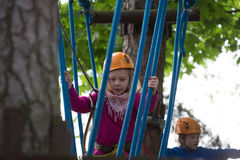 Boy and girl  climbing in adventure park Stock Photography