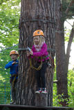 Boy and girl  climbing in adventure park Stock Image