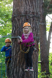Boy and girl  climbing in adventure park Royalty Free Stock Photo