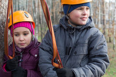 Boy and girl with climbing equipment Stock Photography
