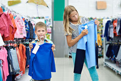 Boy and girl in clothing store Stock Photo