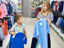 Boy and girl in clothing store Royalty Free Stock Photo