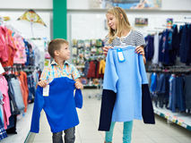 Boy and girl in clothing store Royalty Free Stock Image