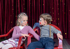 Boy and Girl Clowns Sticking Out Tongues Royalty Free Stock Image