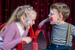Boy and Girl Clowns Sticking Out Tongues Royalty Free Stock Images
