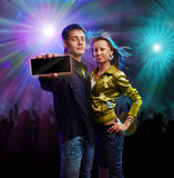 "Boy and girl in a club. Showing card with ""your text place Stock Images"