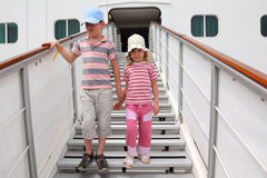 Boy and girl on companion ladder on liner Stock Photos