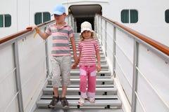 Boy and girl on companion ladder on liner. Little boy and girl standing on companion ladder on large white passenger liner stock photos