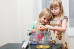 Boy and girl are cooking something Stock Photography