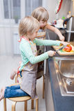 Boy and girl are cooking something Royalty Free Stock Photo