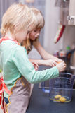 Boy and girl are cooking something Royalty Free Stock Photos