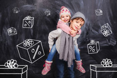 Boy and girl with a coupon boxes Royalty Free Stock Image