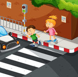 Boy and girl crossing the road Royalty Free Stock Photography