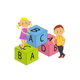 Boy, girl and cubes with letters Royalty Free Stock Images
