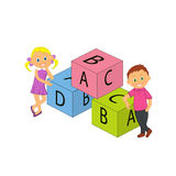Boy, girl and cubes with letters Stock Image
