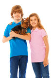 Boy and girl with cute little dog Royalty Free Stock Photo