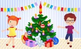 Boy and girl dancing around the christmas tree Royalty Free Stock Image