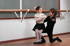 Children dancing in a ballet barre Royalty Free Stock Images