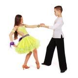 Boy and girl dancing ballroom dance Stock Photos