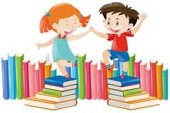 Boy and girl dancing on books Stock Photos