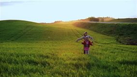 Boy and girl dancing on a green meadow. stock video