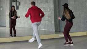 Boy and girl dancing modern dance. Modern style dancers dancing contemporary dance in studio stock video footage