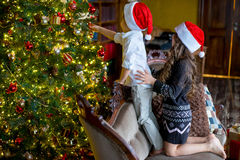 Boy and girl decorate the Christmas tree Royalty Free Stock Photo