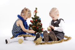 Boy and girl decorate the Christmas tree Stock Image