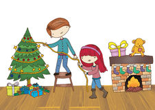 Boy and Girl Decorating Christmas Tree. Young couple decorating the Christmas tree isolated on white background Royalty Free Stock Photo