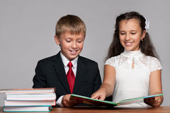 Boy and girl at the desk with books Royalty Free Stock Photography