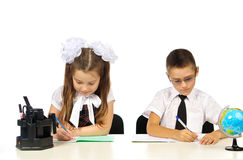 Boy and girl at the desk Stock Photography