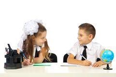 Boy and girl at the desk Royalty Free Stock Images