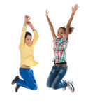 Boy and girl with different complexion jumping. Isolated on white background royalty free stock image