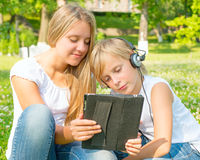 Boy and the girl are in a digital tablet Stock Photos