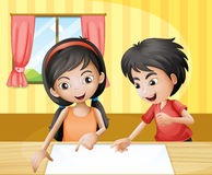 A boy and a girl discussing with an empty signage at the table Stock Image