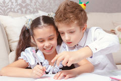 Boy and girl do tasks together Royalty Free Stock Image