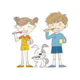 Boy, girl and dog brushing teeth together Stock Photo