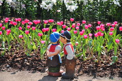Boy and girl doll  in Tulips garden Royalty Free Stock Image