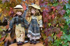 Boy and girl dolls in autumn royalty free stock image