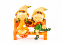 Boy and Girl Dolls sitting on Bench.  Stock Images