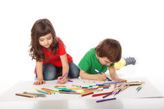 Boy and girl doodling. Image of girl and boy doodling, on white background Royalty Free Stock Image
