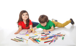 Boy and girl doodling. Image of girl and boy doodling, on white background Stock Photos