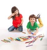 Boy and girl doodling. Image of girl and boy doodling, on white background Stock Image