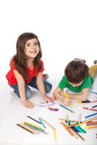Boy and girl doodling. Image of girl and boy doodling, on white background Stock Images