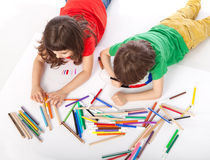 Boy and girl doodling. Image of girl and boy doodling, on white background Royalty Free Stock Photos