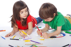 Boy and girl doodling Royalty Free Stock Photography